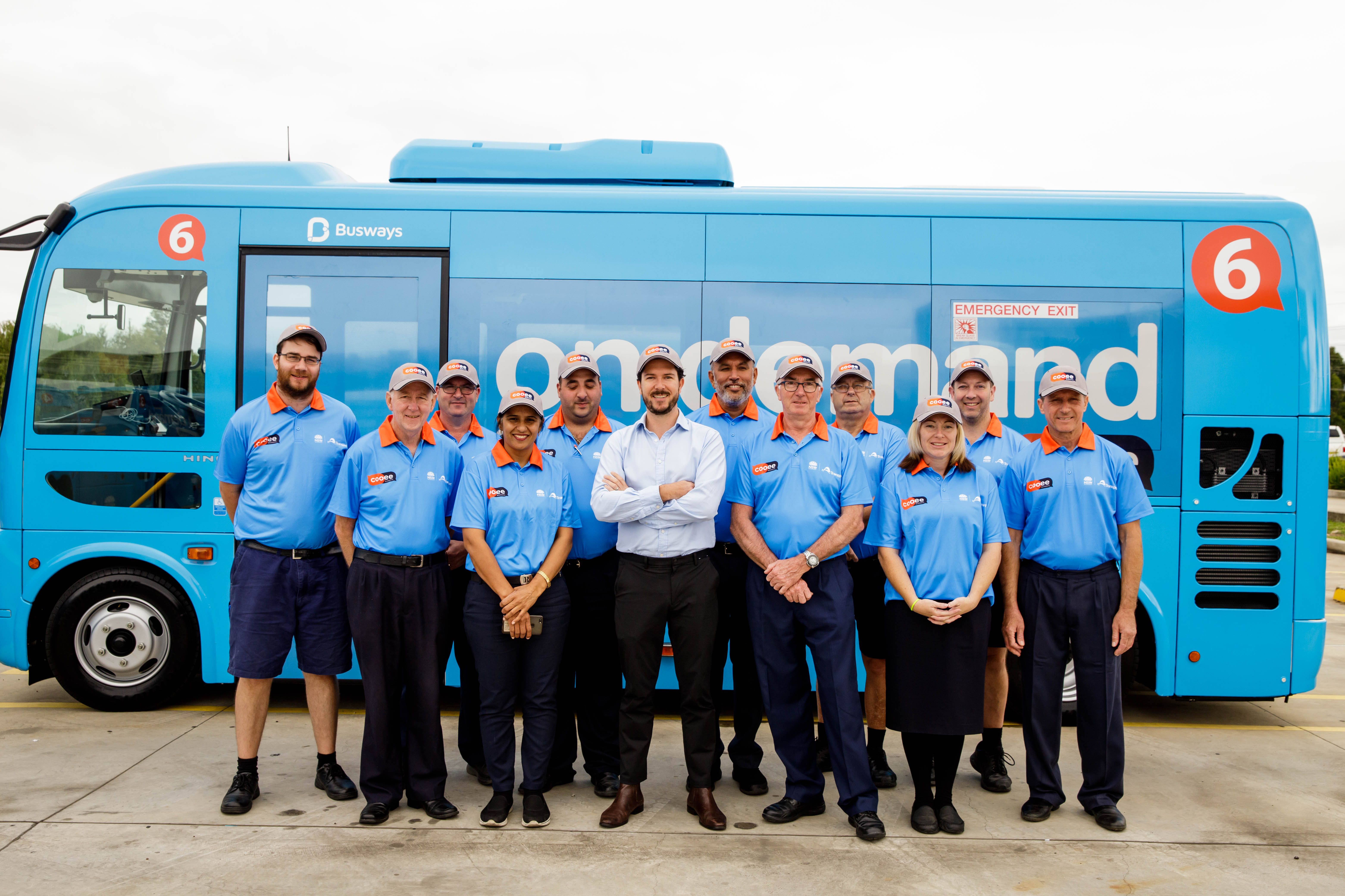 This is a photo of Cooee Busways drivers and Busways' MD.